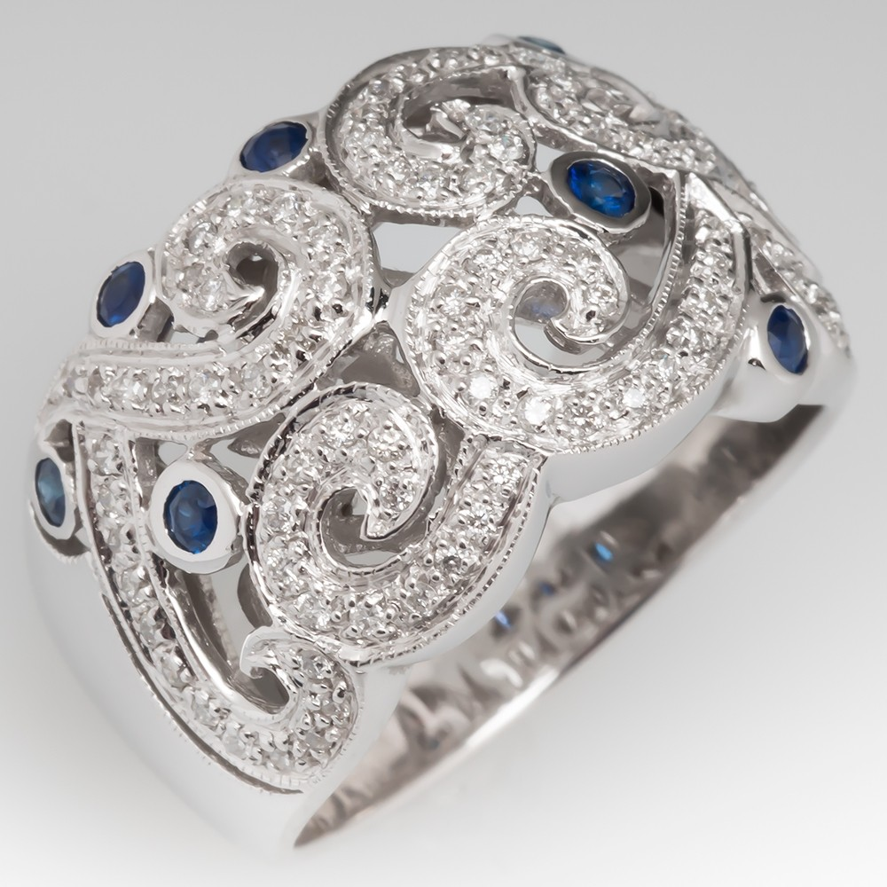Wide Band Scroll Motif Cocktail Ring with Diamonds and Sapphires