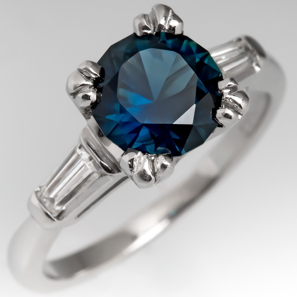 Dark Greenish-Blue Sapphire Ring with Platinum Fishtail Prongs