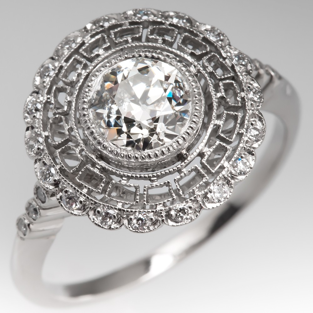 Match Cheryl Burke with this gorgeous diamond halo filigree engagement ring.