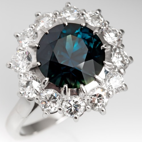 Dark Blue Green Sapphire & Diamond Halo Ring in Platinum