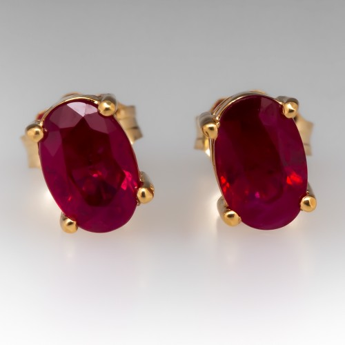 Oval Ruby 4-Prong Stud Earrings 14K Yellow Gold 1.48CTW