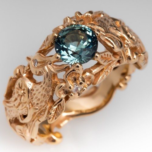 Yellow Gold Engraved Bird and Floral Motif Blue Green Sapphire Ring