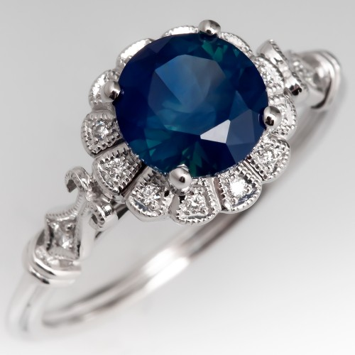 Blue Sapphire Engagement Ring with Intricate 14K White Gold Halo Mounting