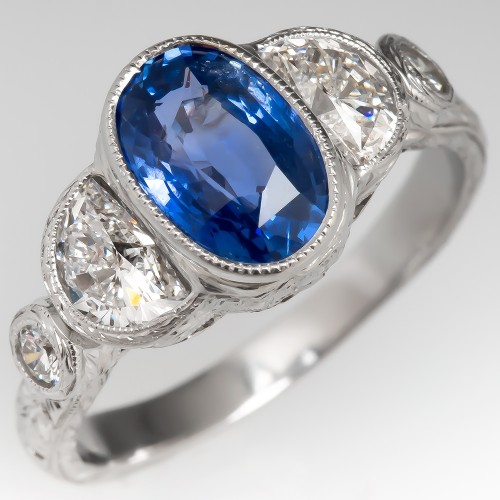 Oval Blue Sapphire & Half Moon Diamond Bezel Set Ring